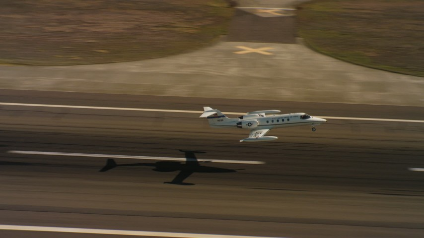 4K stock footage aerial video of a Learjet C-21 taking off from Travis Air Force Base, California Aerial Stock Footage | WAAF02_C066_0117D0_S000