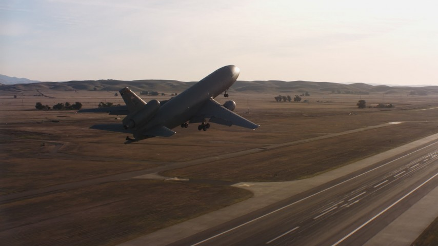 4K stock footage aerial video of a McDonnell Douglas KC-10 lifting off from Travis Air Force Base, California Aerial Stock Footage   WAAF03_C004_0118CL