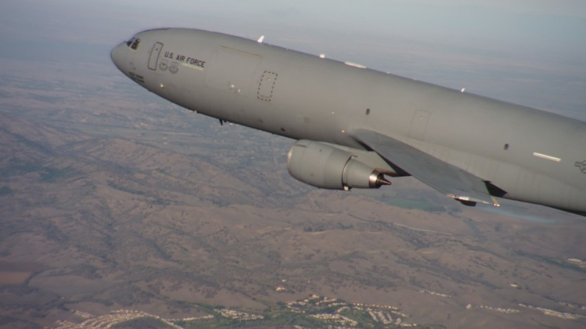 4K stock footage aerial video of a McDonnell Douglas KC-10 flying over hills in Northern California Aerial Stock Footage | WAAF03_C007_01183X