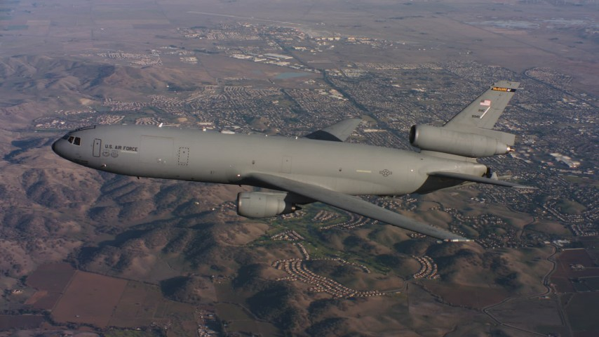 4K stock footage aerial video of a McDonnell Douglas KC-10 flying over hills in Northern California Aerial Stock Footage | WAAF03_C009_0118C0