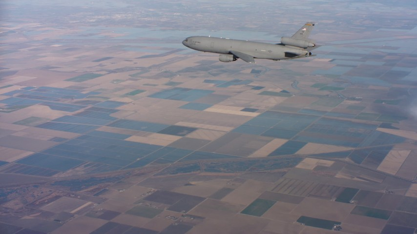 4K aerial video of flying around the tail of a McDonnell Douglas KC-10 over farmland in Northern California Aerial Stock Footage | WAAF03_C015_01181L
