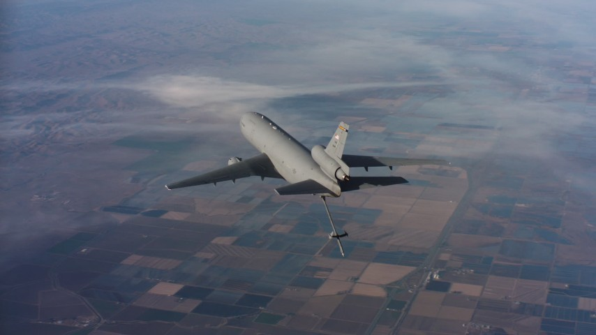 4K stock footage aerial video of flying around a McDonnell Douglas KC-10 lowering the refueling boom, Northern California Aerial Stock Footage | WAAF03_C018_011858
