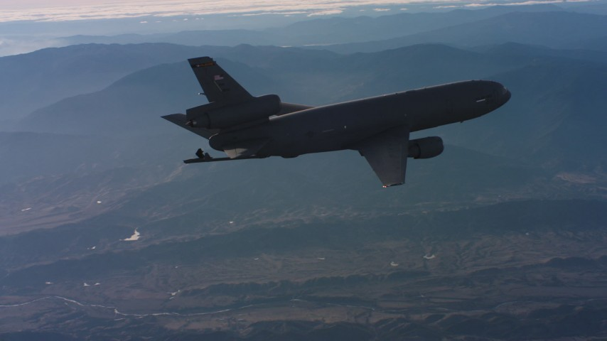 4K stock footage aerial video of a McDonnell Douglas KC-10 with lowered refueling boom in Northern California Aerial Stock Footage | WAAF03_C022_0118MW