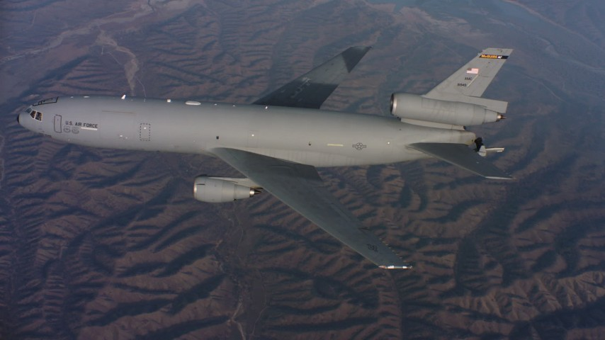 4K stock footage aerial video of a McDonnell Douglas KC-10 flying over hills in Northern California Aerial Stock Footage | WAAF03_C024_0118QQ