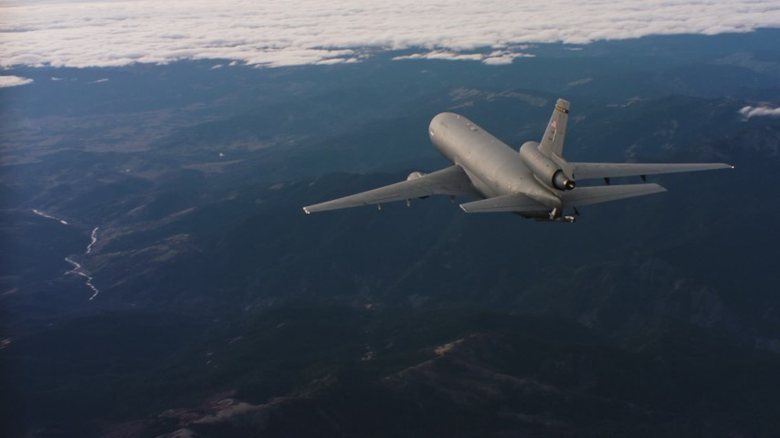 4K aerial video of a McDonnell Douglas KC-10 in flight over mountains in Northern California Aerial Stock Footage | WAAF03_C029_01181U