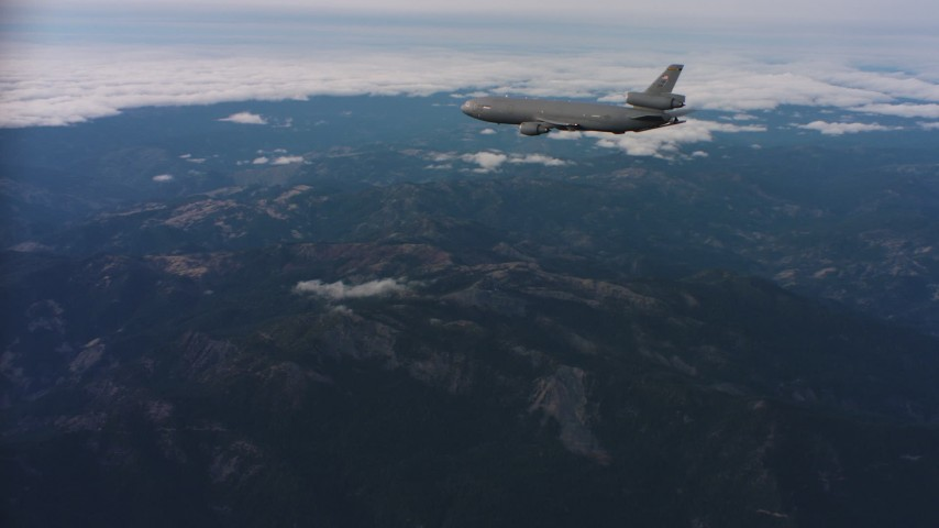 4K aerial video of a McDonnell Douglas KC-10 in flight over mountains in Northern California Aerial Stock Footage | WAAF03_C030_0118EM
