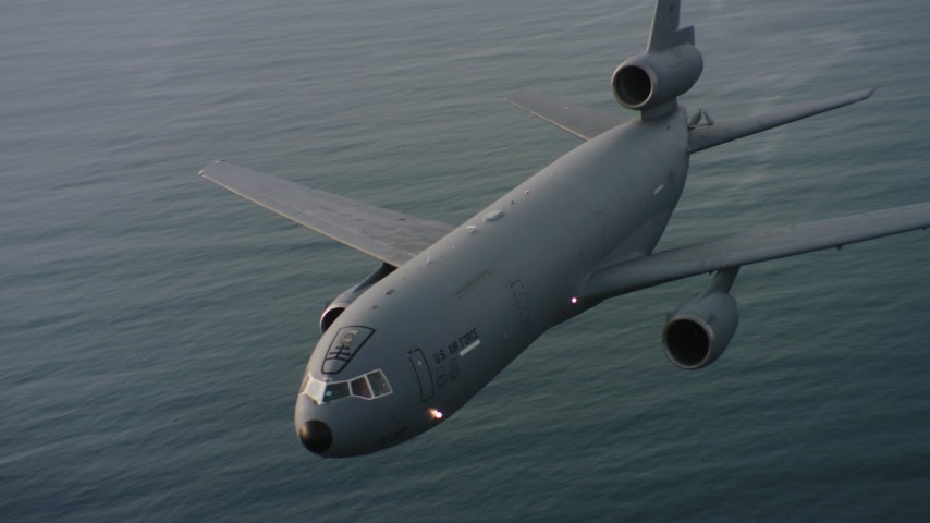 4K aerial ideo of flying around the nose of a McDonnell Douglas KC-10 over the ocean in Northern California Aerial Stock Footage | WAAF03_C044_01181Q