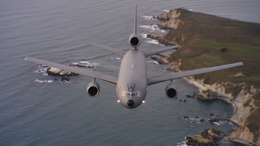 4K stock footage aerial video of a reverse view of a McDonnell Douglas KC-10 flying by the coast of Northern California Aerial Stock Footage | WAAF03_C053_01188P