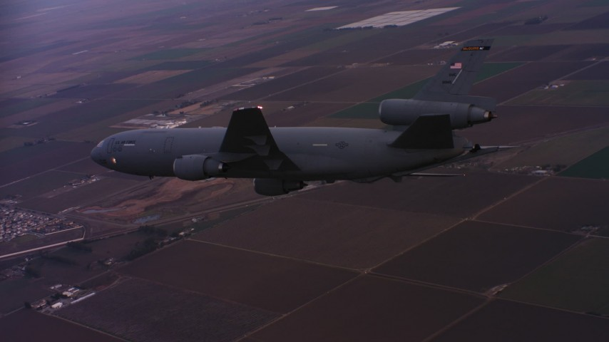 4K stock footage aerial video of a McDonnell Douglas KC-10 in flight over farmland at sunset in Northern California Aerial Stock Footage | WAAF03_C070_0118QG