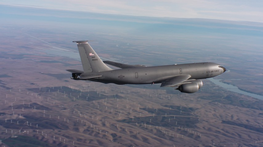 4K stock footage aerial video of a Boeing KC-135 flying over hills toward a bay in Northern California Aerial Stock Footage | WAAF04_C008_0118BS