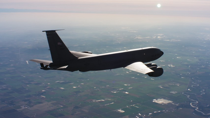 4K stock footage aerial video of a Boeing KC-135 flying over farmland in Northern California Aerial Stock Footage | WAAF04_C015_0118WU
