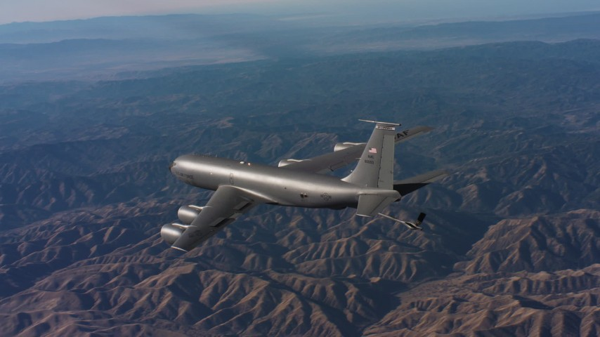 4K stock footage aerial video of revealing a Boeing KC-135 flying over mountains in Northern California Aerial Stock Footage | WAAF04_C019_0118SM