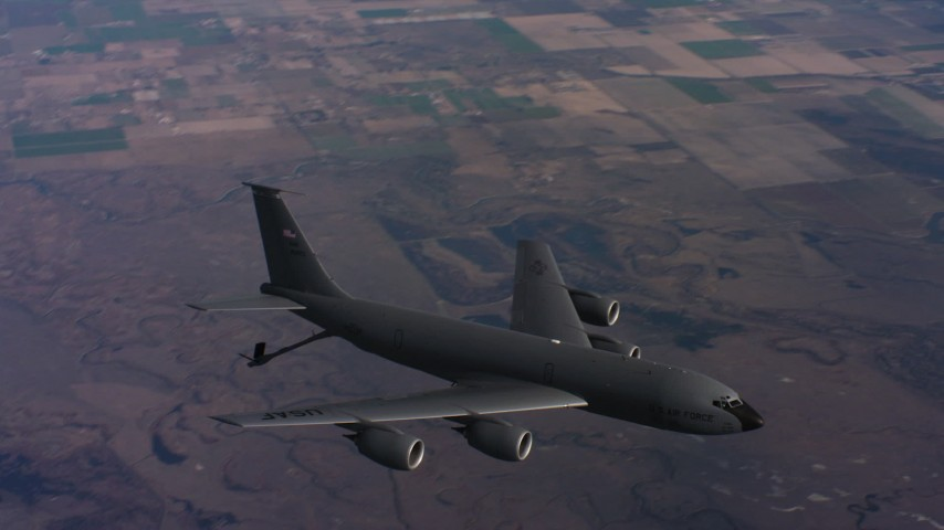 4K stock footage aerial video of a Boeing KC-135 flying over farms with lowered fuel boom in Northern California Aerial Stock Footage | WAAF04_C022_0118CS
