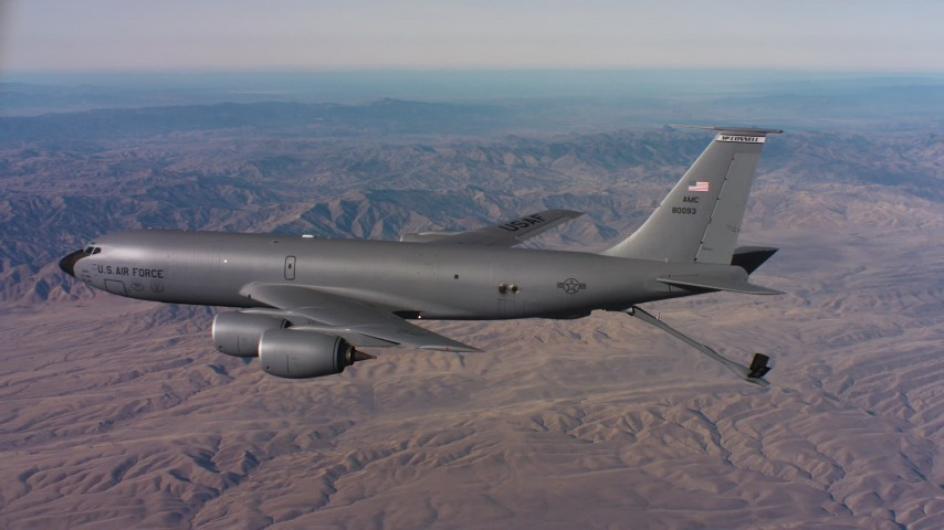 4K stock footage aerial video pan to reveal a Boeing KC-135 flying over mountains in Northern California Aerial Stock Footage | WAAF04_C025_0118FV