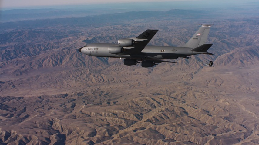 4K stock footage aerial video of a Boeing KC-135 flying over mountains in Northern California Aerial Stock Footage | WAAF04_C027_0118PJ