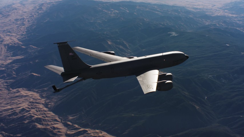 4K stock footage aerial video of a Boeing KC-135 flying over mountains, lowering refueling boom, Northern California Aerial Stock Footage | WAAF04_C029_0118JN