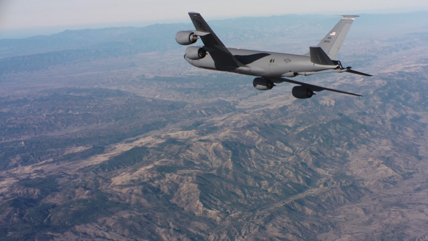 4K aerial video of a Boeing KC-135 in flight high above mountains in Northern California Aerial Stock Footage | WAAF04_C033_0118M4