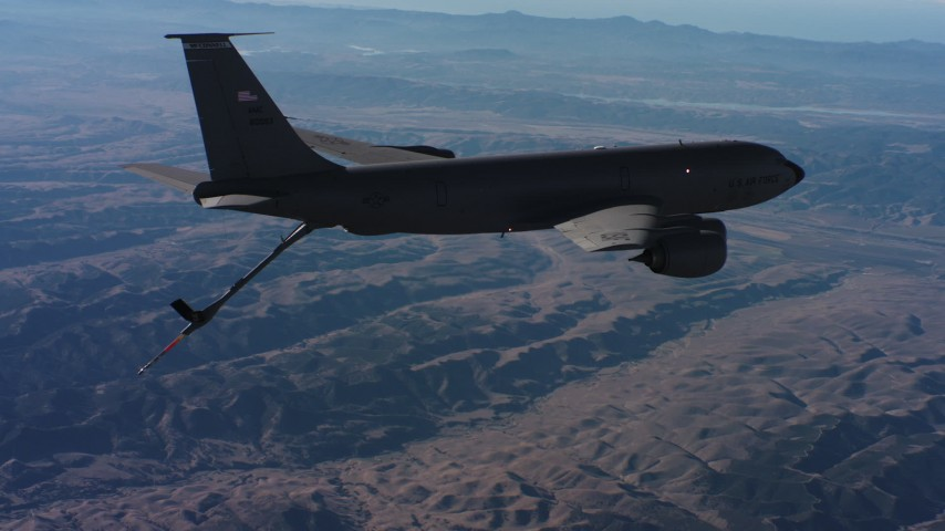4K stock footage aerial video of a Boeing KC-135 flying high above mountains in Northern California Aerial Stock Footage | WAAF04_C036_0118W9