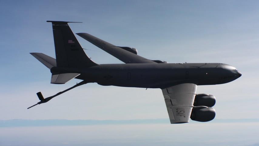 4K aerial video of a Boeing KC-135 raising fuel boom in flight over Northern California Aerial Stock Footage | WAAF04_C039_0118J9_S001