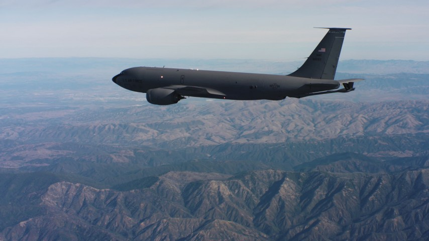4K stock footage aerial video of tracking a Boeing KC-135 over mountains in Northern California Aerial Stock Footage | WAAF04_C049_0118DR