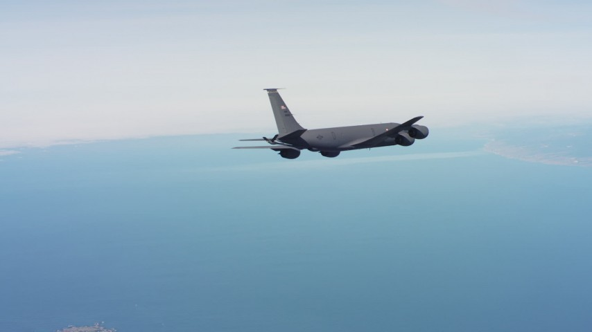 4K stock footage aerial video of a Boeing KC-135 flying over the ocean in Northern California Aerial Stock Footage | WAAF04_C058_01181M