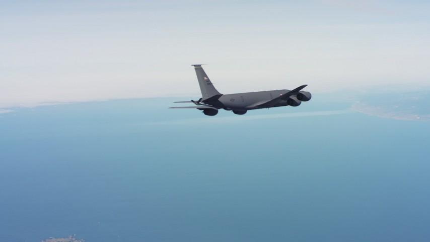 4K aerial video of a Boeing KC-135 flying over the ocean in Northern California Aerial Stock Footage | WAAF04_C058_01181M