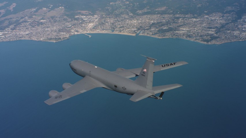 4K stock footage aerial video of a Boeing KC-135 in flight over the ocean near the coast in Northern California Aerial Stock Footage | WAAF04_C064_0118TE