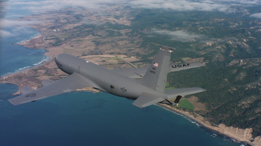 4K stock footage aerial video of revealing a Boeing KC-135 as it flies over coastal clouds in Northern California Aerial Stock Footage | WAAF04_C069_011863