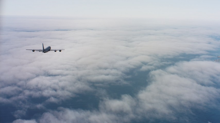 4K aerial stock footage video of a Boeing KC-135 flying over low coastal clouds in Northern California Aerial Stock Footage | WAAF04_C069_011863_S000