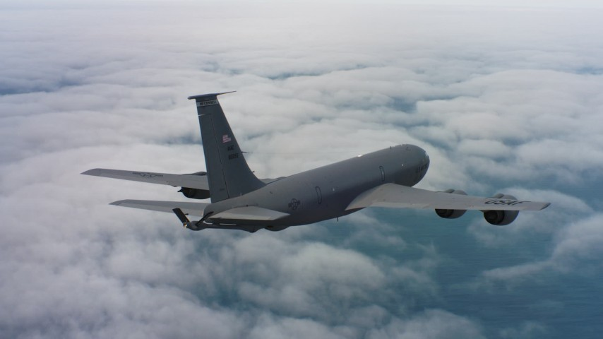 4K stock footage aerial video of a Boeing KC-135 above clouds over the Pacific Ocean in Northern California Aerial Stock Footage | WAAF04_C070_0118HE