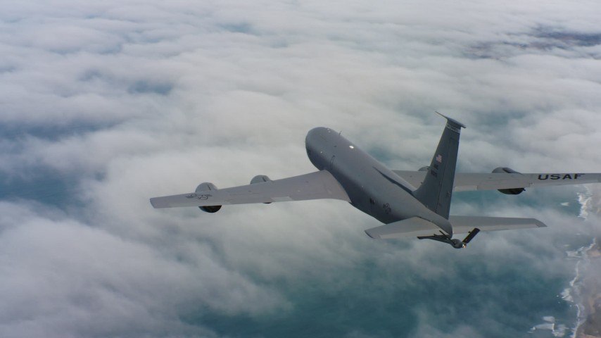 4K stock footage aerial video of a Boeing KC-135 flying over clouds on the coast in Northern California Aerial Stock Footage | WAAF04_C070_0118HE_S000