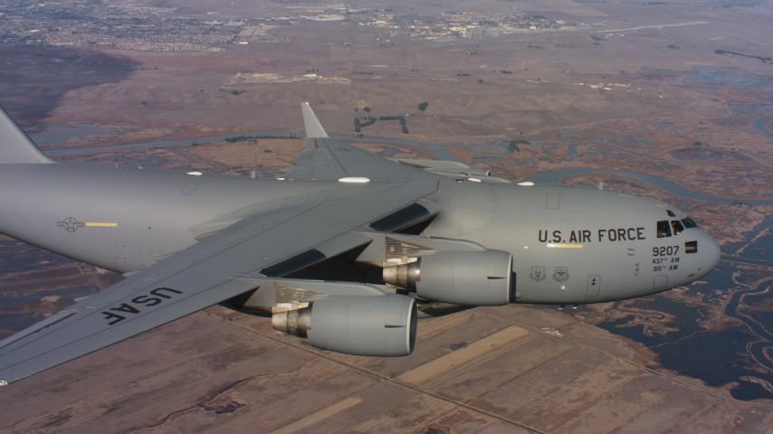 4K aerial video of a Boeing C-17 flying over wetlands in Northern California Aerial Stock Footage | WAAF05_C004_0118EU
