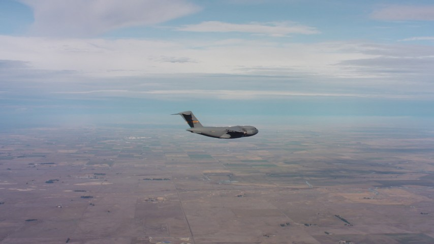 4K stock footage aerial video of a Boeing C-17 flying over farmland in Northern California Aerial Stock Footage   WAAF05_C006_0118HE