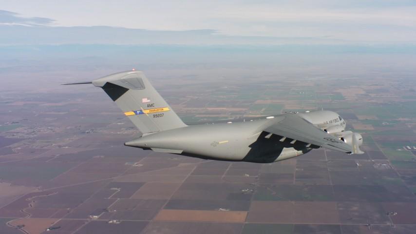4K stock footage aerial video of a Boeing C-17 flying above farmland in Northern California Aerial Stock Footage | WAAF05_C015_01189N