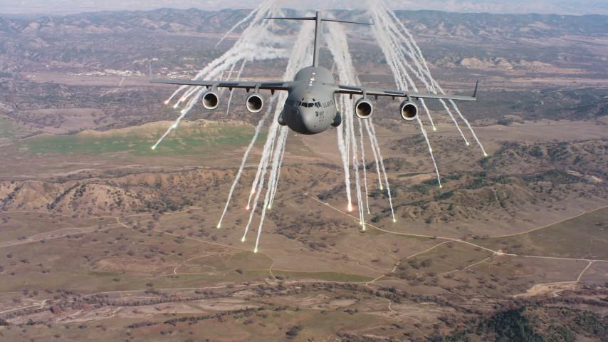 4K stock footage aerial video of a Boeing C-17 shooting flares in Northern California Aerial Stock Footage WAAF05_C033_0118KE