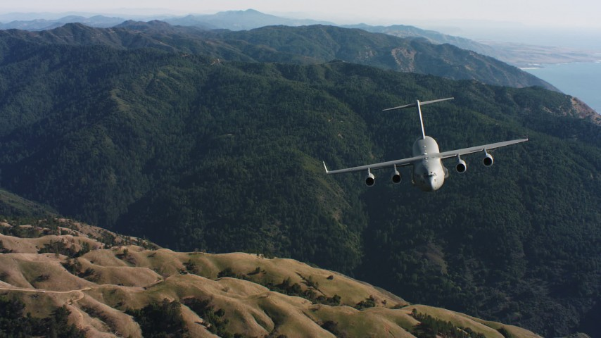 4K stock footage aerial video of a reverse view of a Boeing C-17 over mountains in Northern California Aerial Stock Footage WAAF05_C035_0118SM | Axiom Images