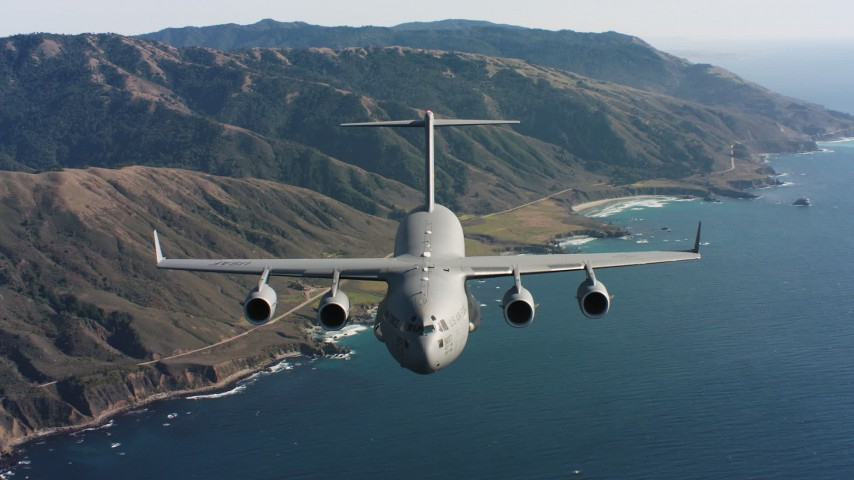 4K aerial stock footage video of reverse view of a Boeing C-17 on the coast of Northern California Aerial Stock Footage | WAAF05_C036_01183S