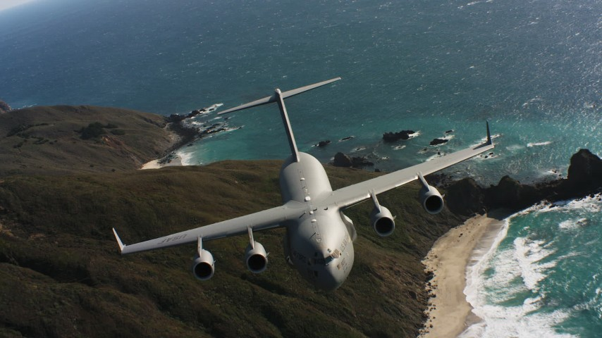 4K stock footage aerial video of a Boeing C-17 following the coastline of Northern California Aerial Stock Footage | WAAF05_C040_0118VW