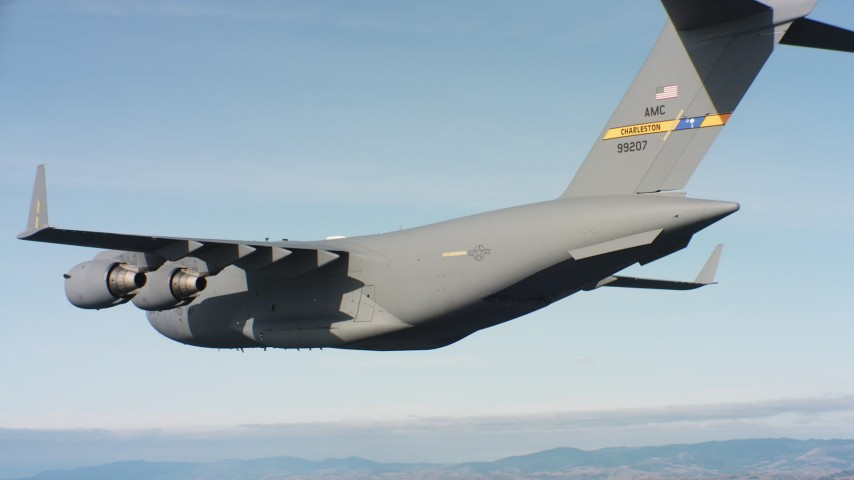 4K stock footage aerial video of a Boeing C-17 with cargo doors opening in flight over Northern California  Aerial Stock Footage | WAAF05_C058_0118SP