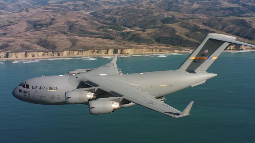 4K aerial video of a Boeing C-17 flying over ocean as cargo doors close in Northern California  Aerial Stock Footage | WAAF05_C059_011850