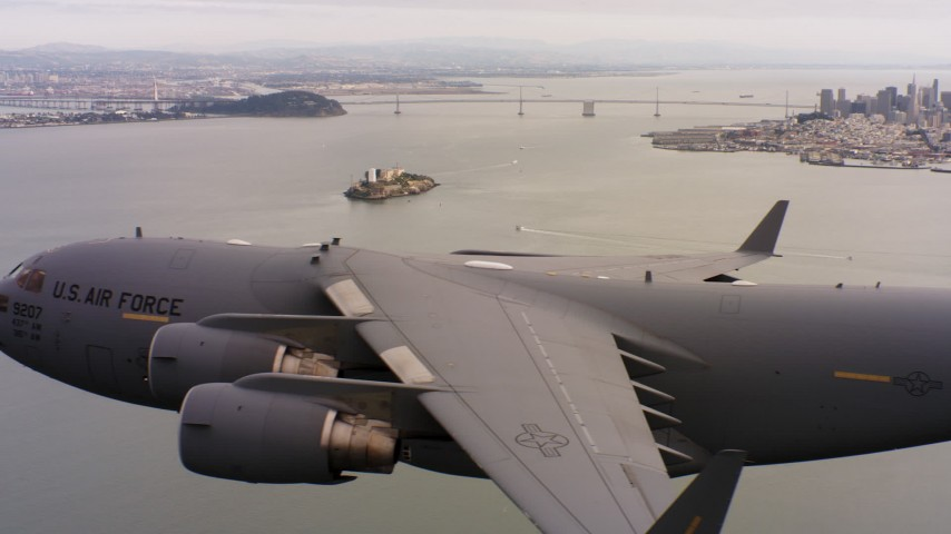 4K stock footage aerial video of a Boeing C-17 flying near Alcatraz and San Francisco, California Aerial Stock Footage WAAF05_C067_0118DB | Axiom Images