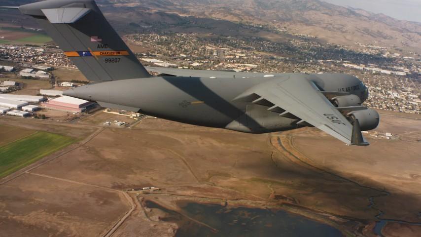 4K stock footage aerial video of a Boeing C-17 in flight near neighborhoods in Northern California Aerial Stock Footage | WAAF05_C074_01187N