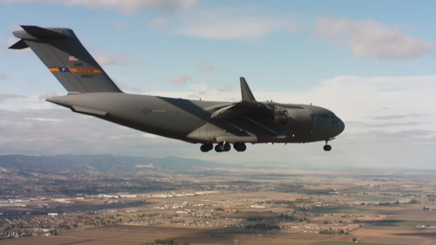 4K stock footage aerial video of a Boeing C-17 near Travis Air Force Base with landing gear down, Northern California Aerial Stock Footage | WAAF05_C076_0118DH