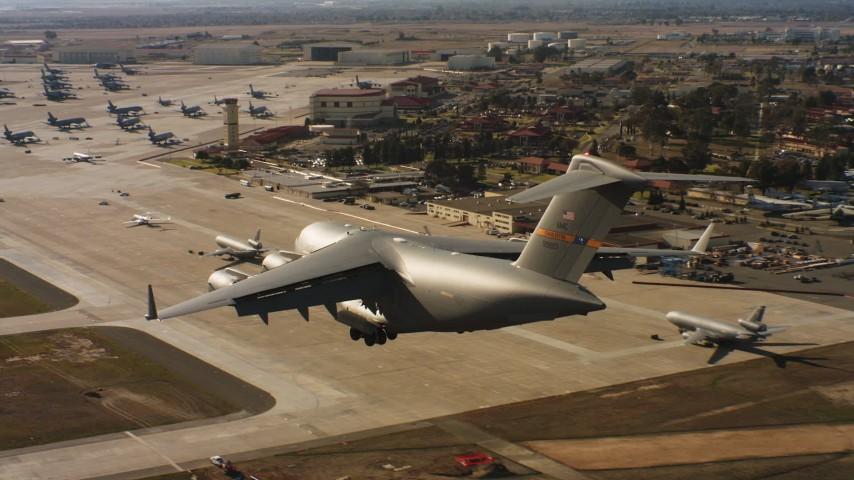 4K aerial stock footage video of a Boeing C-17 landing at Travis Air Force Base, California Aerial Stock Footage | WAAF05_C080_0118FB
