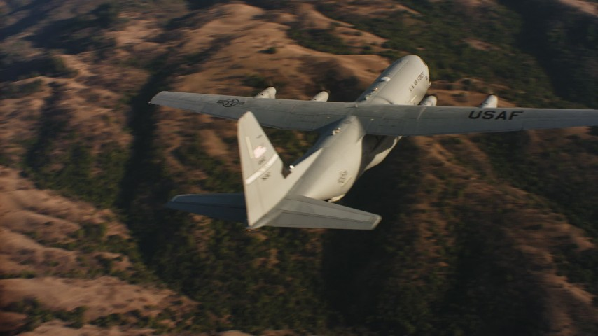 4K stock footage aerial video of flying around the tail of a Lockheed Martin C-130J at sunset in Northern California  Aerial Stock Footage | WAAF06_C021_01198P