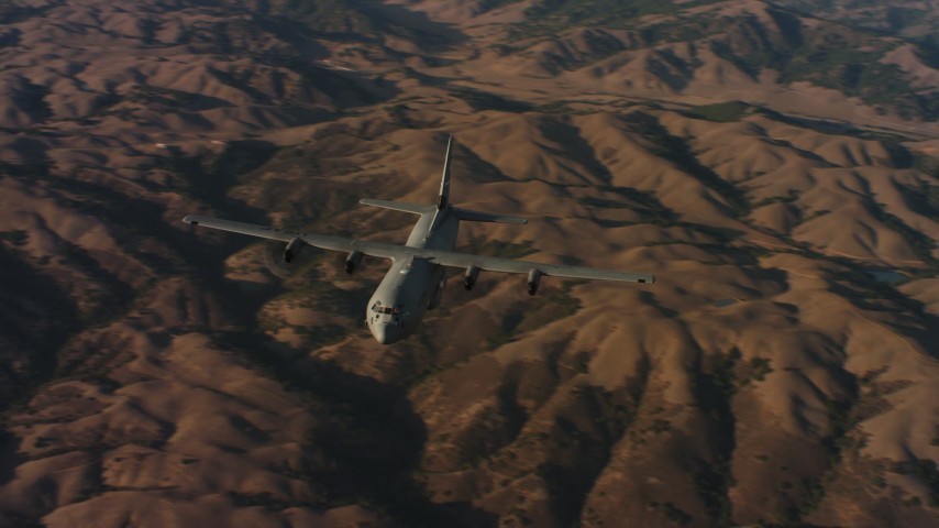 4K aerial video of flying around the front of a Lockheed Martin C-130J at sunset in Northern California Aerial Stock Footage | WAAF06_C024_0119KD