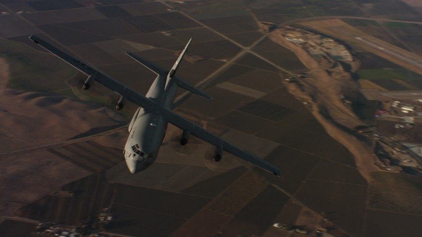 4K aerial video of flying around the front end of a Lockheed Martin C-130J at sunset, Northern California Aerial Stock Footage | WAAF06_C026_0119G8