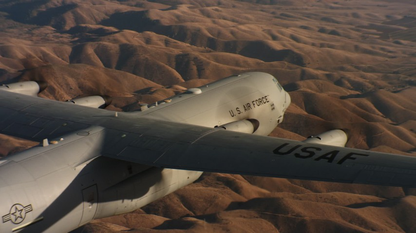 4K aerial video pan across the body of a Lockheed Martin C-130J at sunset in Northern California Aerial Stock Footage | WAAF06_C031_0119QR