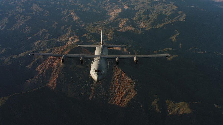 4K stock footage aerial video of a reverse view of a Lockheed Martin C-130J over mountains at sunset in Northern California Aerial Stock Footage | WAAF06_C041_0119KA