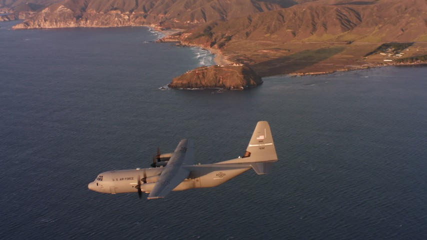 4K stock footage aerial video of a Lockheed Martin C-130J flying near the coast of Northern California at sunset Aerial Stock Footage | WAAF06_C057_0119EM
